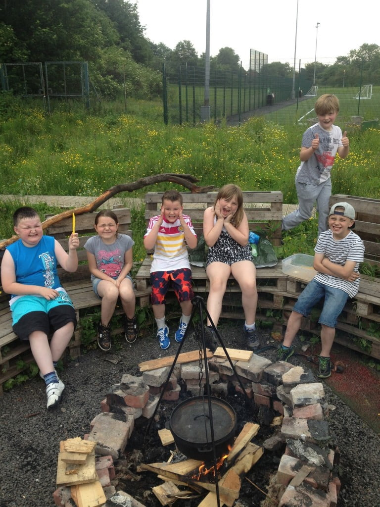Kids around campfire